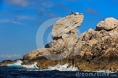 Sculpture on top of a rock