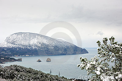 Sea bay with snowy mountain on background