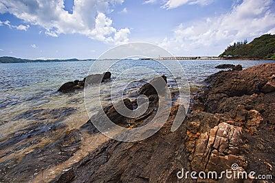 Sea beach and rock on blue sky