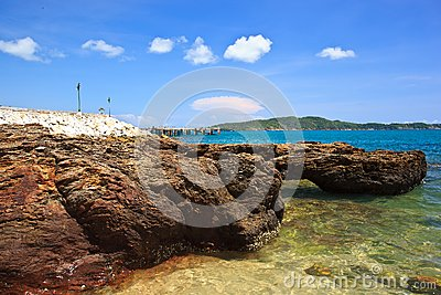 Sea beach and rock on blue sky
