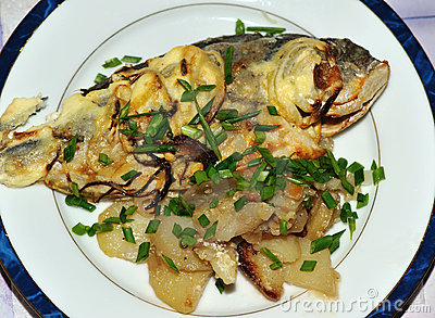 Sea bream cooking on the plate