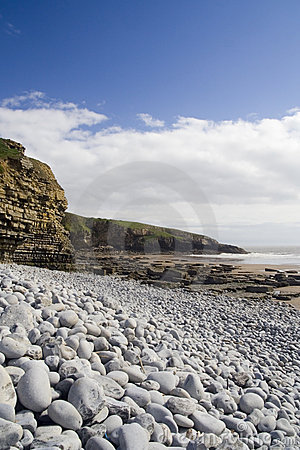 Free Sea Cliffs And Pebbles. Royalty Free Stock Photography - 792047