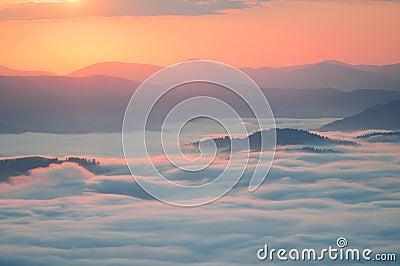 Sea of clouds in mountain at sunrise. Carpathians, the ridge Borzhava, Ukraine. Stock Photo