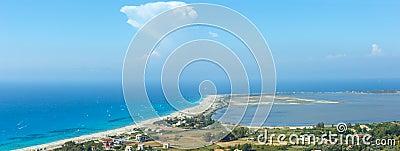Sea coast panorama and kiteboarders.