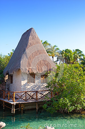 The sea coast with the traditional house in Xcaret park near Cozumel, Mexico