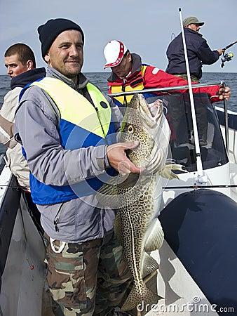 Sea fisherman with huge cod