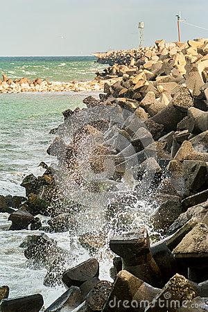 Sea hitting a stone dam