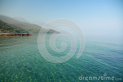 Sea with house from izmir under blue sky