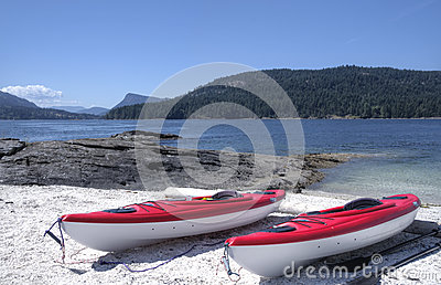 Sea kayaks on an isolated west coast beach