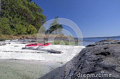 Sea kayaks on an  west coast beach