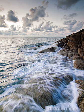 Sea and rock at the sunset
