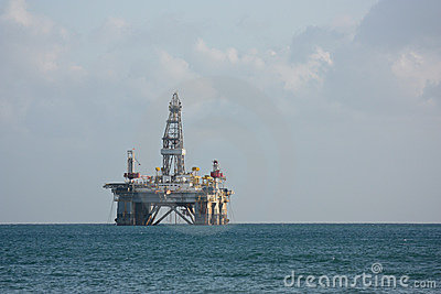 Sea side oil rig. Editorial Stock Image