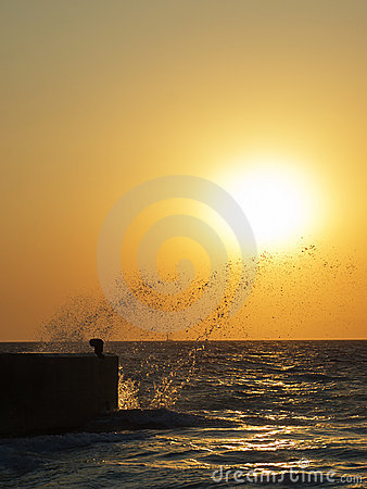 Sea splashes at sunset