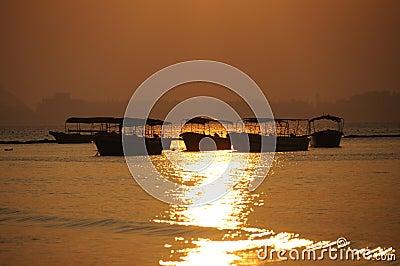 Sea at sunrise with boats