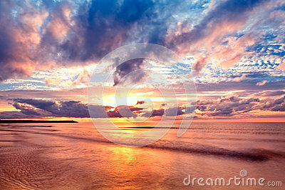Sea at sunrise with nice waves