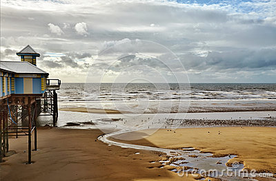 Sea view at Blackpool, with sandy beach and pier.