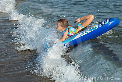Sea wave flips the child.