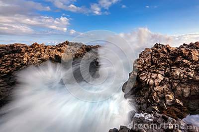 Sea waves breaking on rocks