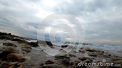 Sea waves splashing a coastline and camera stock footage