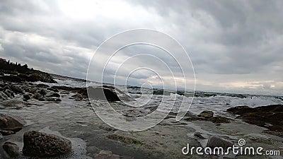 Sea waves splashing a coastline. Slow motion shot. stock footage