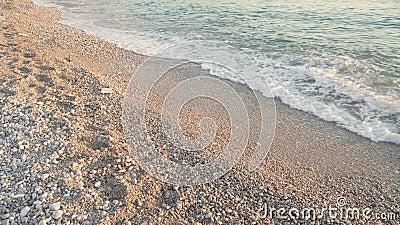 Sea waves at sunset beach. Adriatic sea. Pebbles beach seashore. Coastline waves closeup 4k. Sea waves at sunset beach. Adriatic sea. Pebbles beach seashore stock footage