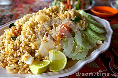 Seafood fried rice with cucumber and lemon