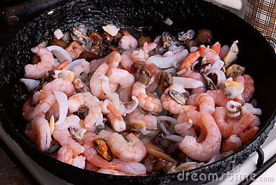 Seafood in a frying pan. Step of cooking