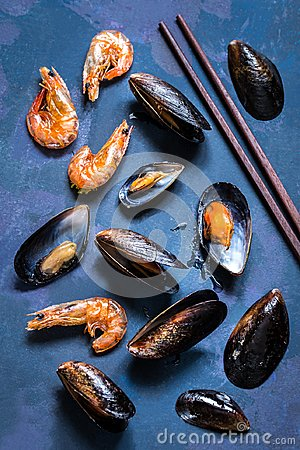Free Seafood Mussels In The Shell And Shrimp On A Blue Background Stock Images - 105405144
