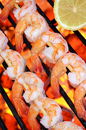 Seafood shrimp skewers on a hot barbecue grill