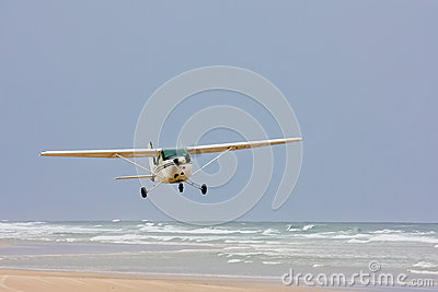 Seaplane taking off from beach