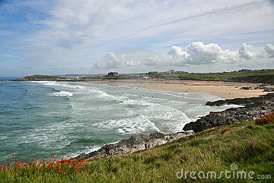 Seascape with coastal line: beach, waves, blue sky