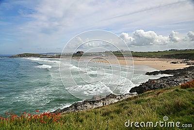 Seascape with coastal line: beach, waves, blue sky