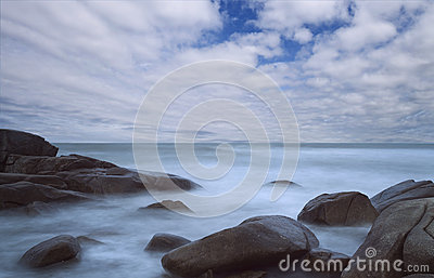 Seascape with long exposure with blue sky