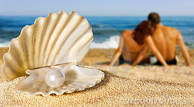 Seashell with pearl on the beach