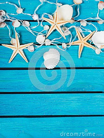 Free Seashells And Sea Stars On Blue Wooden Background Stock Photos - 112143793