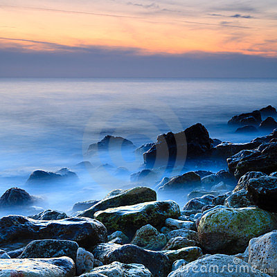 Seashore With Misty Water At Sunset Stock Images - Image: 24113734