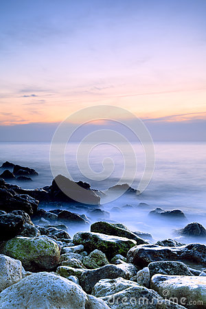 Free Seashore With Misty Water At Sunset Stock Photography - 26441832