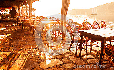 Seaside cafe in sunset light