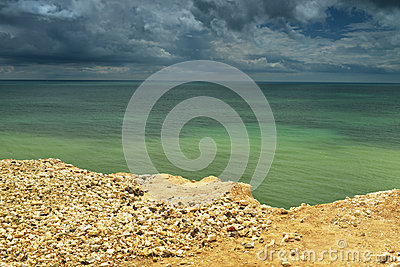 Seaside with cliff edge - green water