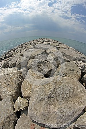 Seaside rocks and breakwaters photographed with the fisheye lens