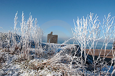 Season view ballybunion castle and beach in snow