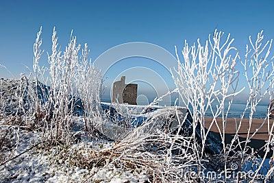 Season view ballybunion castle and beach in snow