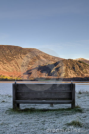Seat with a view across Ennerdale Water. Vertical.