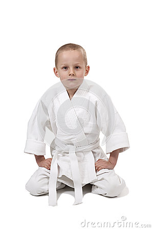 Seated boy in judo kimono,