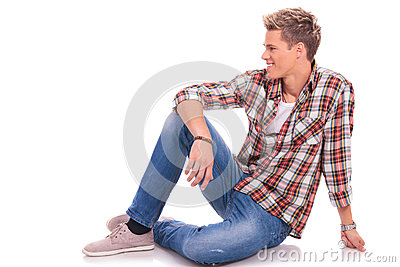 Seated casual man looking to side