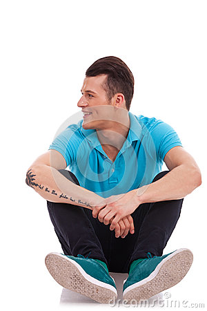 Seated man looking to side