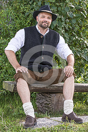 Seated man in traditional Bavarian costumes