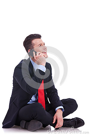 Seated young business man talking on the phone