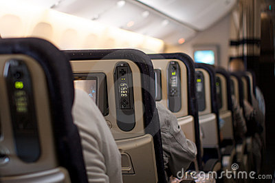 Seats, remotes and screens in an airplane