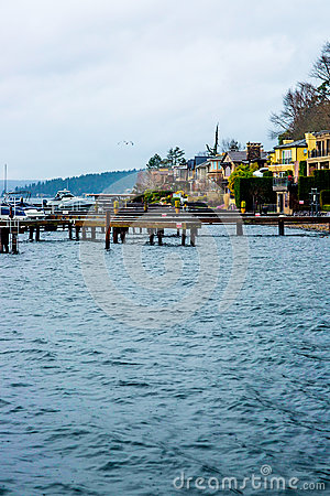 Free Seattle Beach Dock Puget Sound Washington State Harbor Boat Yellow Apartment Blue Water Rocks Trees Evergreen Beautiful Bay Landsc Royalty Free Stock Image - 95991056